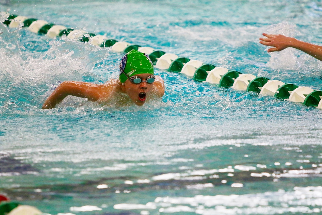 young swimmer competing